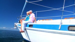 stock-footage-healthy-retired-couple-enjoying-leisure-aboard-their-luxury-sailing-boat-filmed-at-fps